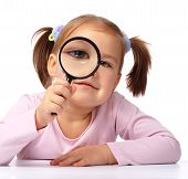 Curious Girl Is Looking Through Magnifying Glass