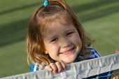 Beautiful girl at tennis court