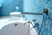 picture of lavabo  - Blue bathroom closeup with little blue mosaic tiles - JPG
