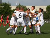 Happy football team after goal
