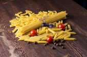 Постер, плакат: Pasta With Different Types Of Italian Pasta Uncooked Pasta On The Table Mixed Dried Pasta Selecti