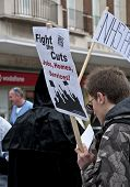 Members from Exeter Anti Cuts Alliance protest about Andrew Lansley's NHS bill