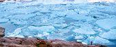 Travel in arctic landscape nature with icebergs - Greenland tourist man explorer - tourist person lo poster