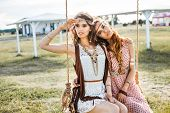 Two Cute Hippie Girl In The Setting Sun, And Ride On A Swing, Outdoors, Best Friends Having Fun And poster