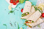 Burritos Wraps With Chicken And Vegetables On Light  Background. Chicken Burrito, Mexican Food. Top  poster