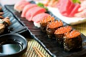 Sushi With Chopsticks And Soy Sauce. Sushi Roll Japanese Food In Restaurant. Salmon Roe Sushi Set Wi poster
