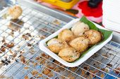 Sweet And Savory Grilled Coconut-rice Hotcakes Use Name kanom Krok , Sometimes Use Coconut Rice Ca poster