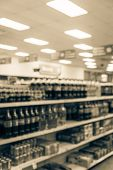 Vintage Blurred Soft Drinks Aisle At Pharmacy Store In Usa poster