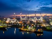 Aerial View Of Twilight Of Oil Refinery ,shot From Drone Of Oil Refinery And Petrochemical Plant At  poster