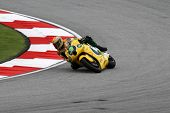 SEPANG, MALAYSIA - OCTOBER 22: Moto2 rider Simone Corsi competes with other riders at qualifying rac
