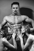 Womens Competition. Sexy Muscular Man With Women poster
