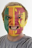 Face Of Crazy Angry Man Painted In Colors Of Sri Lanka Flag