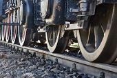 Steam locomotive detail with cranks and wheels poster
