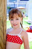 bikini kid girl water wet in pool garden holding sunroof pole