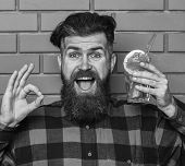 Hipster Enjoy Drink Or Cocktail. Man Shows Ok Gesture On Brick Wall Background. Hipster With Beard A poster