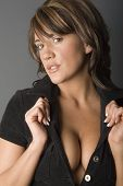 pic of streetwalkers  - Beautiful woman holding blouse open to show cleavage - JPG