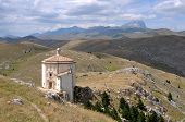 pic of apennines  - ancient church in barren landscape of apennines high mountains - JPG