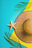 Summer Composition. Tropical Palm Leaves, Straw Beach Hat, Starfish On Pastel Blue And Yellow Backgr poster