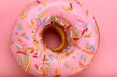 Pink Donut With Colored Sprinkles On A Pink Background, Close-up, Concept Of Desserts, Concept Of Pi poster