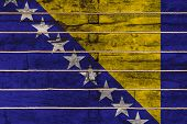 National Flag  Of Bosnia Herzegovina On A Wooden Wall Background. The Concept Of National Pride And  poster