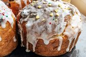 Easter Rustic Cakes With Icing. Glaze Flows Down White Smudges With Colored Powders And Sweets Close poster
