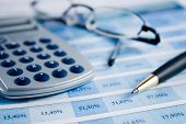 stock photo of social-security  - A calculator pen and a financial statement - JPG