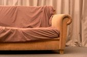 Old Beige Sofa. Crumpled Blanket On The Couch. Modern Style. Cushioned Furniture. Furniture For Rest poster