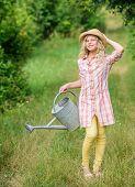 Spring Gardening Checklist. Watering Plants In Garden. Watering Tools. Girl Child Hold Watering Can. poster