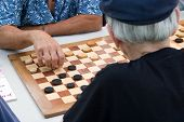 Two Old People Playing Draughts