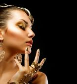 Fashion Girl Portrait. Golden Makeup.