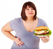 Woman get abdomen pain after eating fatty food. Isolated.
