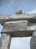 Inuit stone sculpture against blue sky