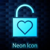 Glowing Neon Lock And Heart Icon Isolated On Brick Wall Background. Locked Heart. Love Symbol And Ke poster
