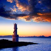Ibiza island sunset of Es Vedra and La  Savina lighthouse in Formentera