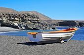 fishing boat in Caleta Negra, a black sand beach in Ajuy, Fuerteventura, Canary Islands, Spain