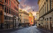 Rome, Italy. Deserted evening street of old town with road of paving stones and high houses. Picture poster