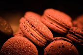 Abstract Delicious And Beautiful Macaroons On Sale. Close Up. Toned Trend Color - Lush Lava Color Of poster