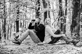 Man With Binoculars And Woman With Metal Mug Enjoy Nature Park. Park Date. Relaxing In Park Together poster