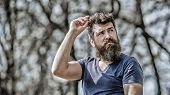 Confident Posture Of Handsome Man. Man Attractive Bearded Hipster Posing Outdoors. Guy Masculine App poster