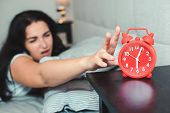 Sleepy Woman Reaching To The Alarm Clock In The Morning With Late Wake Up. Asleep Girl Stopping Alar poster