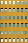 Facade Of Yellow Office Building With Windows. Facade Of An Old Yellow Brick Wall With Windows. Old  poster