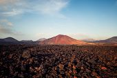 Los Hervideros, Lava Fields In Lanzarote With Volcano Mount View poster