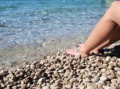 Female feet in the sea
