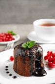 Delicious Warm Chocolate Lava Cake On Plate poster