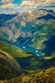 Tourism Vacation And Travel. Fantastic View On Geirangerfjord And Mountains Landscape From Dalsnibba poster
