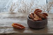 Sliced Apple Slices In Dried Form Lie In A Ceramic Gravy Boat, Next To A Slice Of Apple In The Form  poster