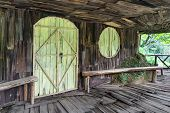 Old Wooden House Hammered From Planks. Facade Of Planks. Vietnam Indochina Asia. poster