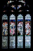 Stainglass window with the 4 evangelists in church in Scotland, UK