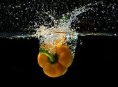 Sweet yellow pepper, splashing in water