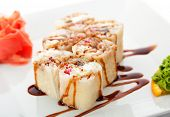 Maki Sushi - Roll made of Smoked Eel, Cream Cheese and Tobiko inside. Tamago (japanese omelet) ousid